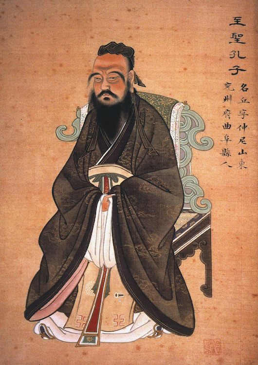 a traditional Chinese painting of Confucius in a long robe with a black beard sitting on a traditional style chair