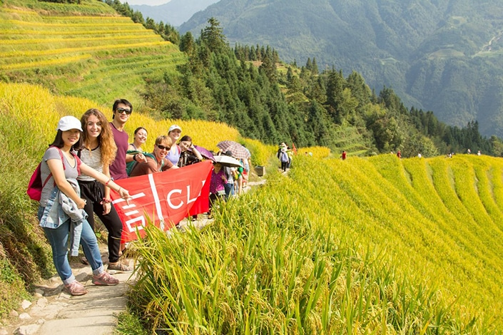 CLI students stand together in the rice terraces of a village near Guilin
