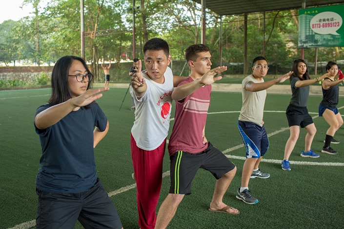 a row of students practicing tai chi