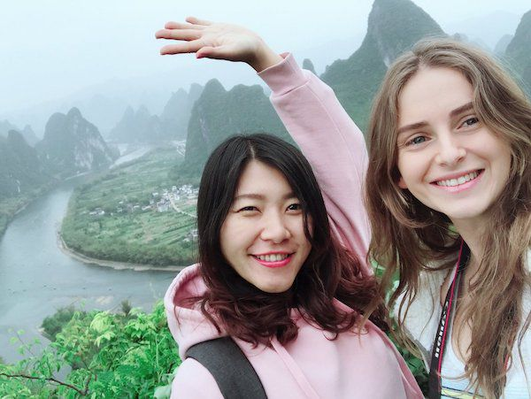 Two CLI students pose in front of karst mountains outside Guilin, China