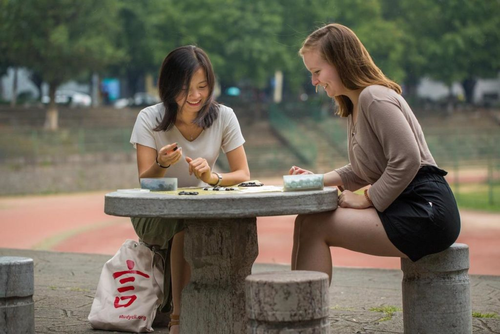 A CLI student and her teacher play a game of go, also known as weiqi