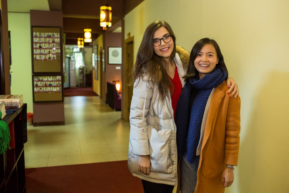 a student and teacher pose together inside the CLI center in China