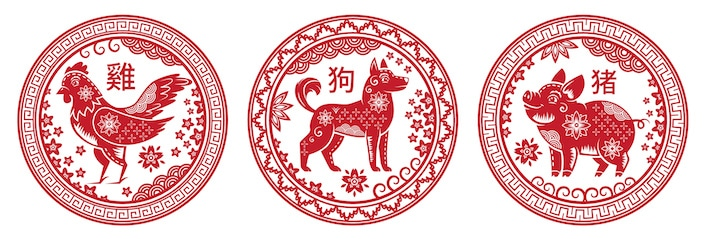 Round red pictures of Chinese zodiac animals (rooster, dog and pig)