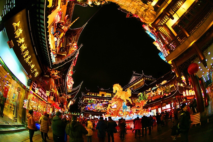 a photo of Chinese buildings and a Chinese Lantern Festival display at night