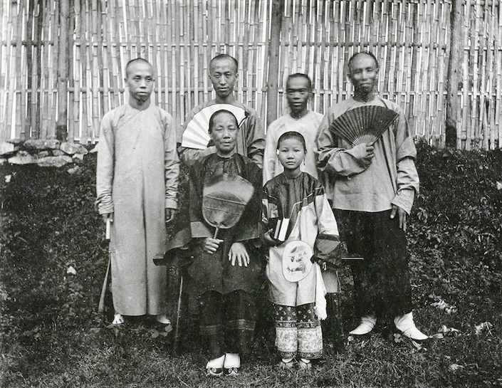 black and white historical photo of Guilin people in traditional dress
