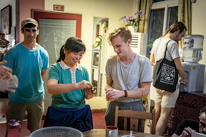 CLI students and interns making zongzi