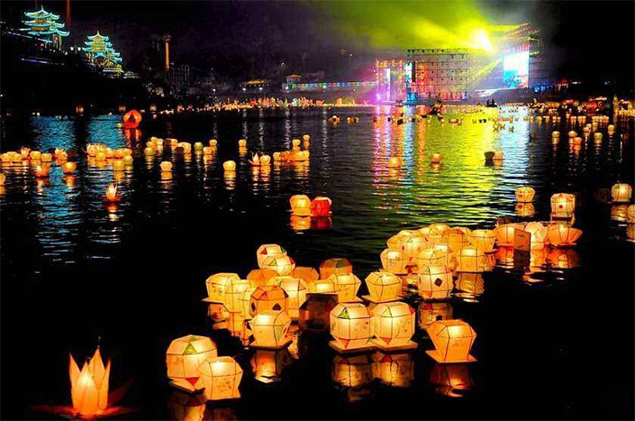 Chinese lanterns floating on a lake.