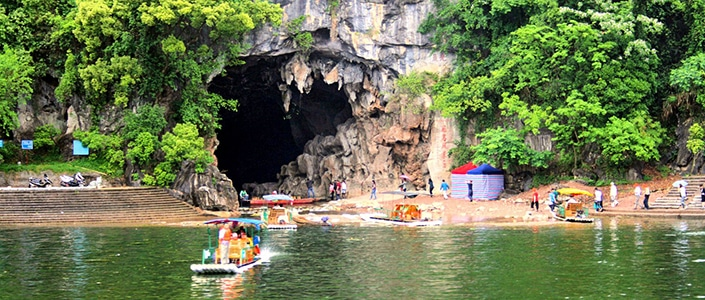 Yangshuo travel guides take travelers to visit a cave outside Yangshuo, China