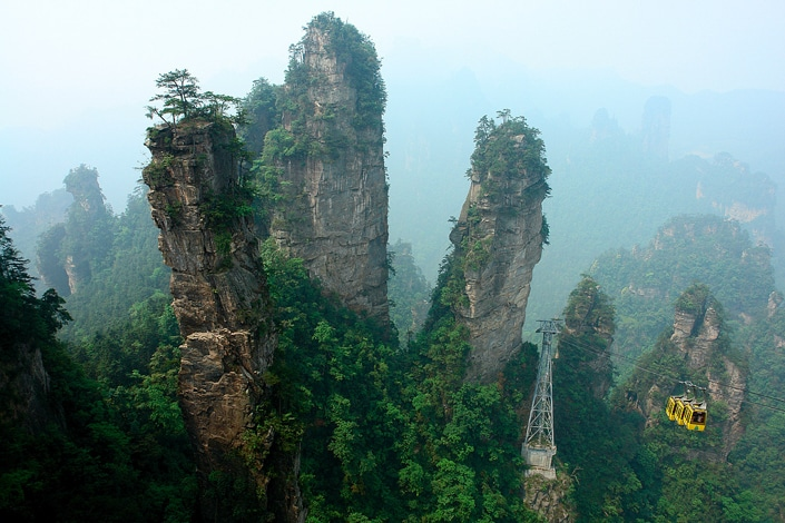 a yellow cable car and the peaks of Zhangjiajie, one of the best places to visit in China