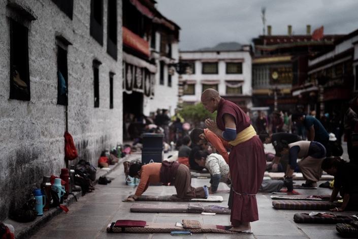 a Tibetan monk prayer at a temple