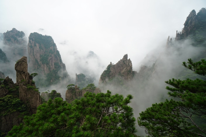 Mountain peaks covered in fog