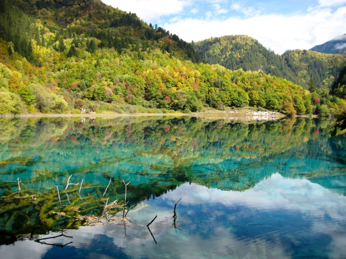 mountains reflected on water in Jiuzhaigou, one of the best places to visit in China