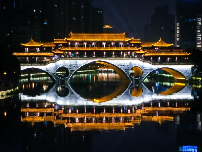 a bridge with lights at night in Chengdu, one of the best places to visit in China