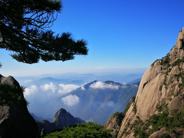 the view from the top of a mountain in Huangshan