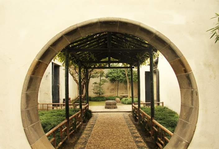 a round door in a traditional Chinese garden in Suzhou, one of the best places to visit in China