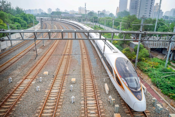 a Chinese fast train and five other train tracks