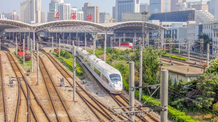 a Chinese train leaving Shanghai Railway Station