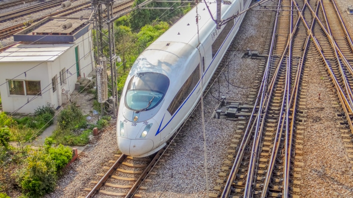 a Chinese fast train and several train tracks