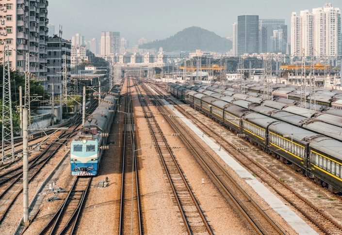 old-fashioned Chinese trains sit in a railyard
