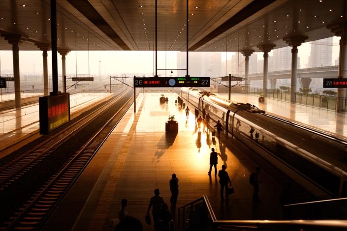 a Chinese train platform at dusk