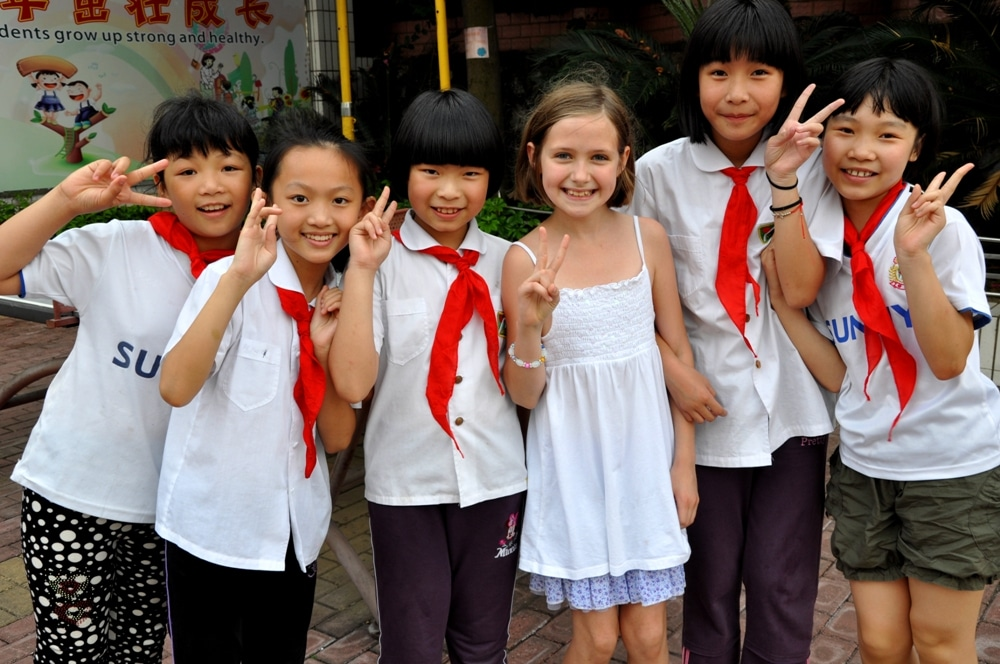 a group of Chinese elementary school students with a western child