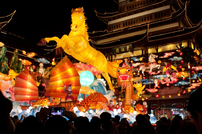 large, yellow Chinese horse lantern and orange boat lantern