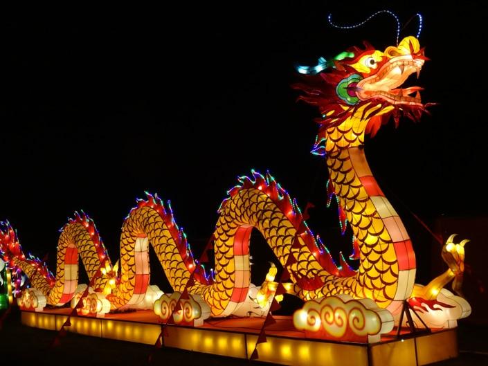 a long, glowing yellow Chinese dragon Lantern Festival lantern