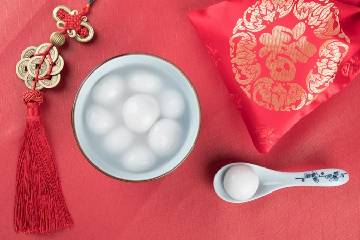 a bowl of Lantern Festival tangyuan on a red tablecloth