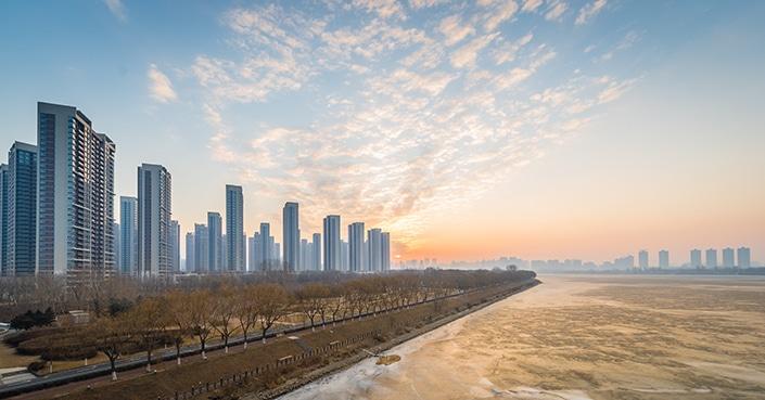 modern apartment buildings next to the sea at dawn in Shenyang, China