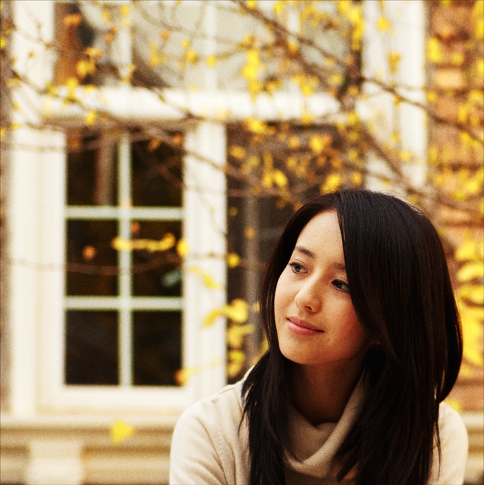 a photo of a Chinese woman looking off to her right