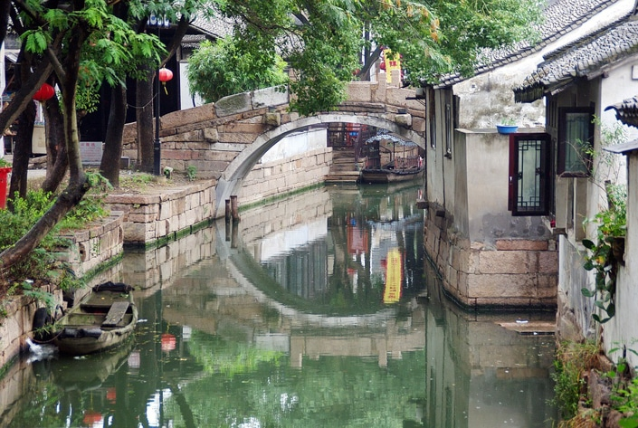 an ancient bridge popular with Suzhou travel guides over a canal in Suzhou