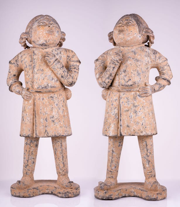 two Tang dynasty statues of foreigners