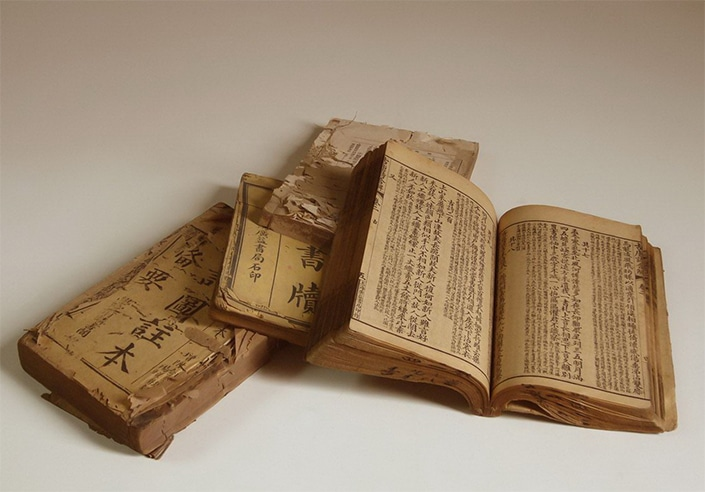 a pile of old books written using Chinese characters