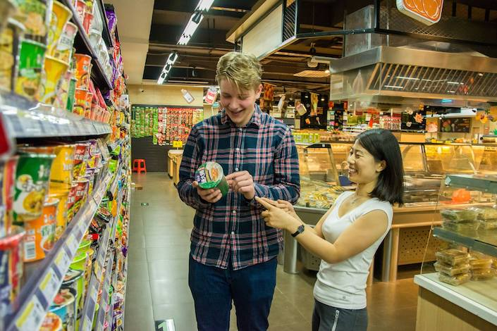 a CLI teacher and student shopping together at the supermarket