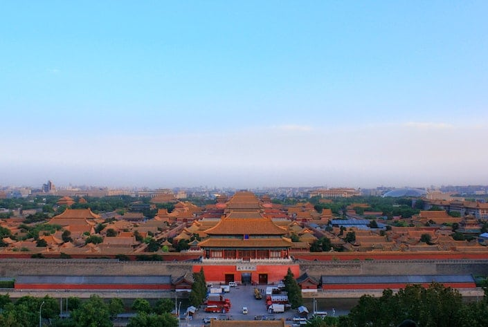an aerial view of the Forbidden City in Beijing at dusk