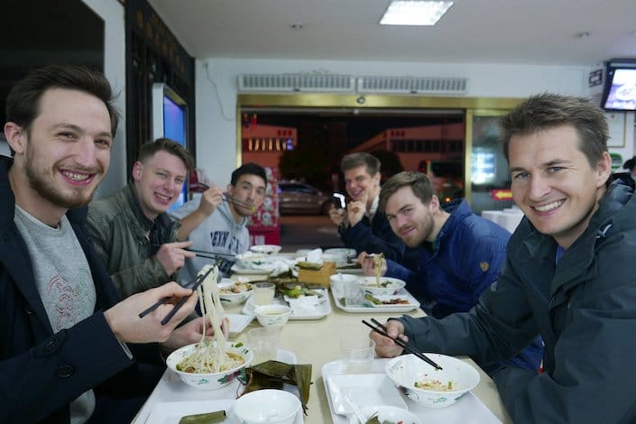 a group of CLI students enjoying Guilin rice noodles at a local restaurant