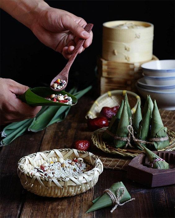 a photo of someone making Chinese zongzi