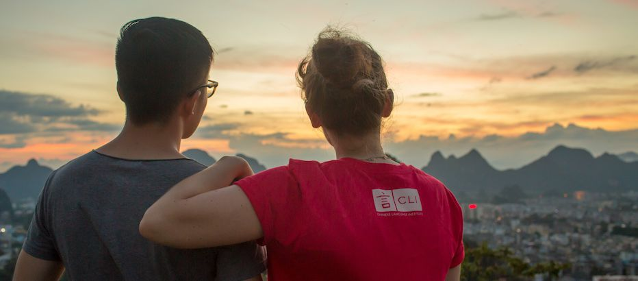 CLI staff members stare towards distant mountains at dusk