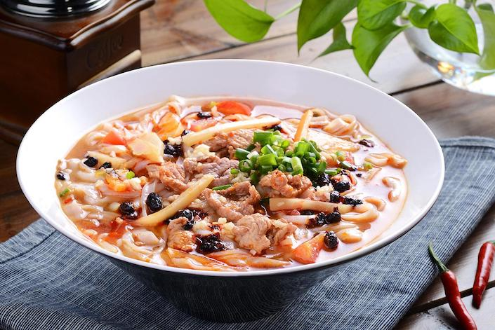 a bowl of Guilin rice noodles with pickled black beans and pork