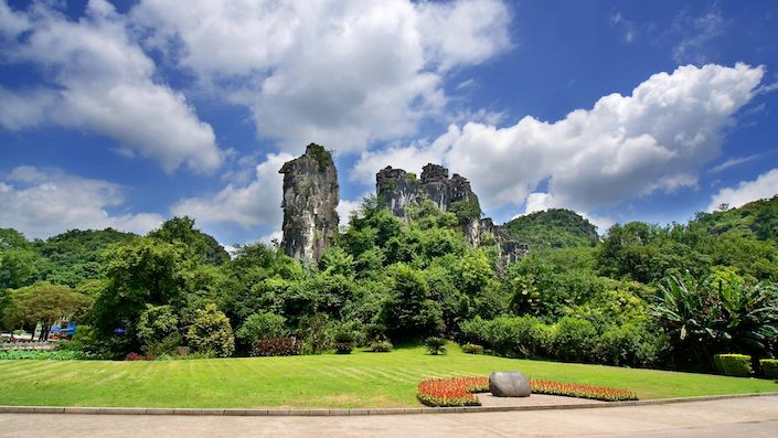 karst peaks surrounded by vegetation on a sunny day in Seven Star Park