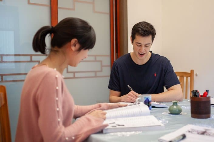 a CLI teacher and student during Chinese class