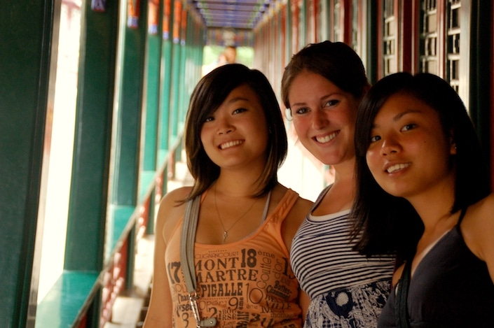 a group of three CLI students posing in the Long Corridor in the Summer Palace