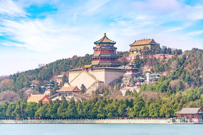 a picture of a pagoda rising above Kunming Lake in the Summer Palace, Beijing