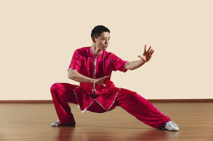 Young man in red practicing Chinese martial arts