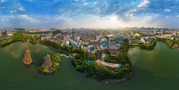 an aerial view of the Sun and Moon Pagodas in Guilin, China
