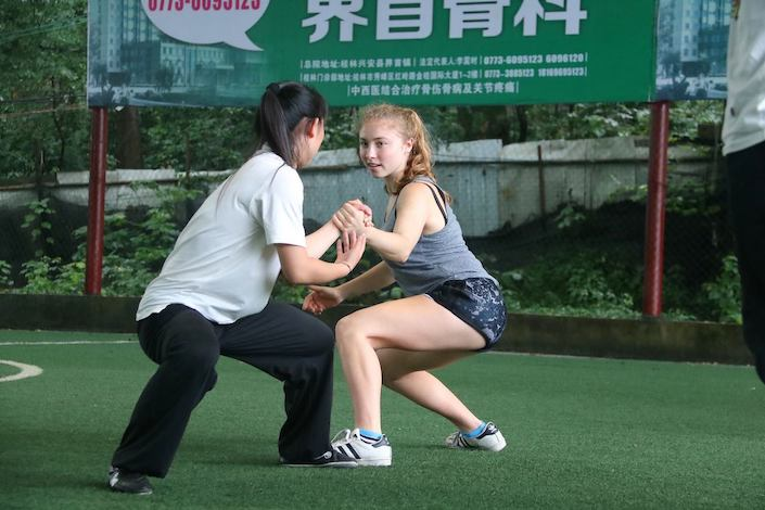 American university student practicing martial arts in China with an instructor
