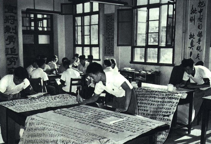 a black and white photograph showing Chinese university students writing big character posters during the Cultural Revolution