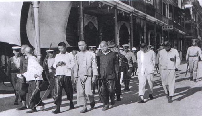 a black and white photograph of members of the Chinese communist party who were arrested by the Kuomintang in 1927