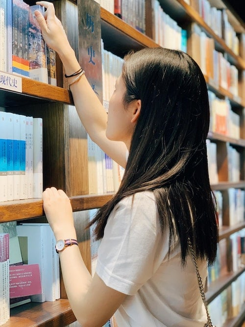chinese girl browsing books at library