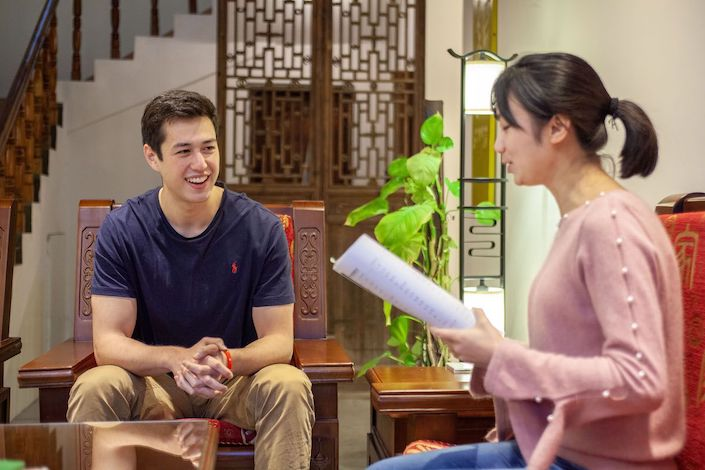 student and teacher learning chinese